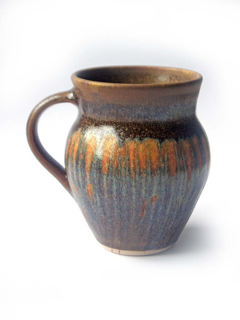 Mug with rutile and iron stipes